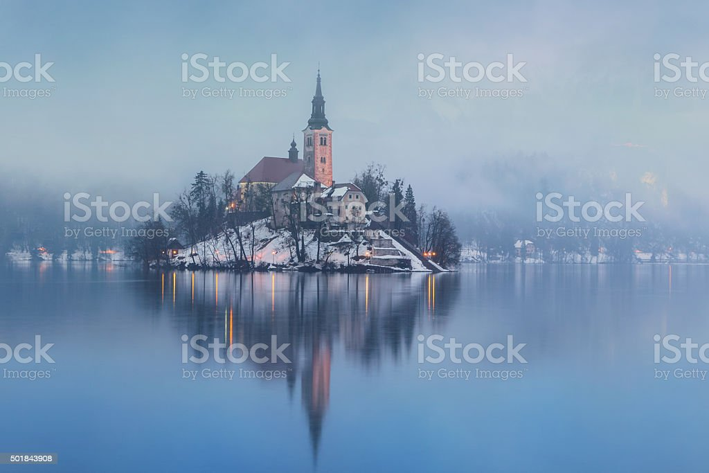 Foggy evening on Bled lake at winter stock photo