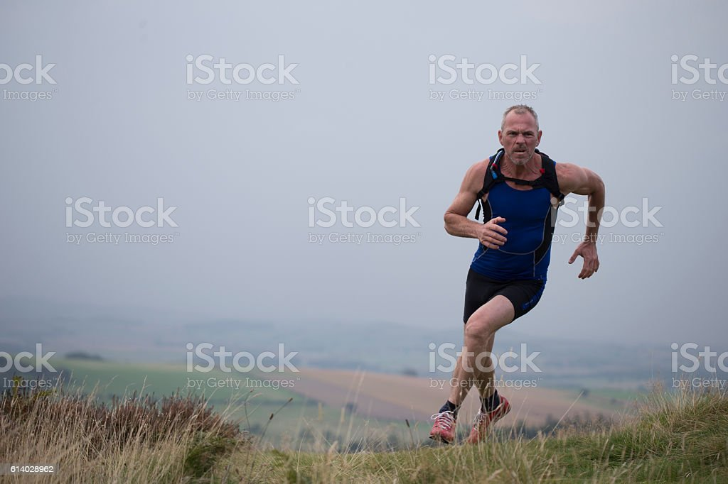Foggy Fell Running stock photo