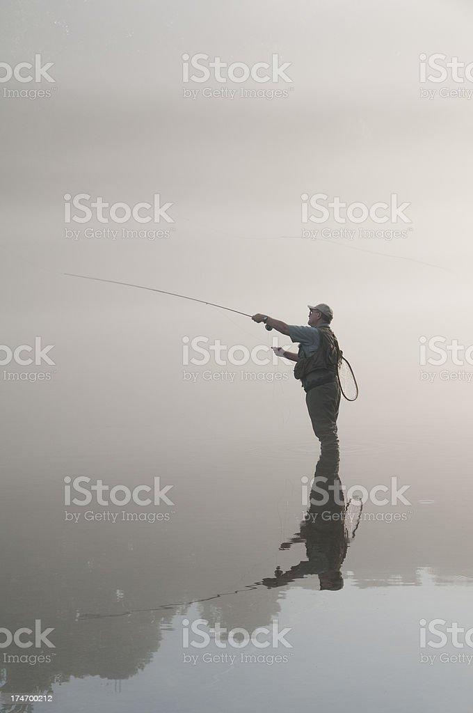 Foggy Fisherman royalty-free stock photo