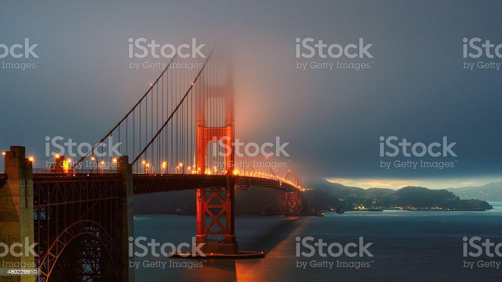Foggy Golden Gate Bridge at sunset, San Francisco, California, USA stock photo
