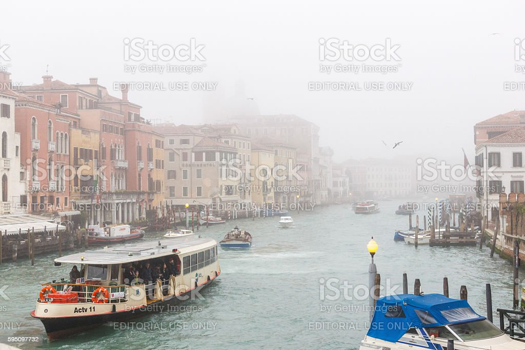 Foggy Grand Canal in Venice with Vaporetto and boats. stock photo