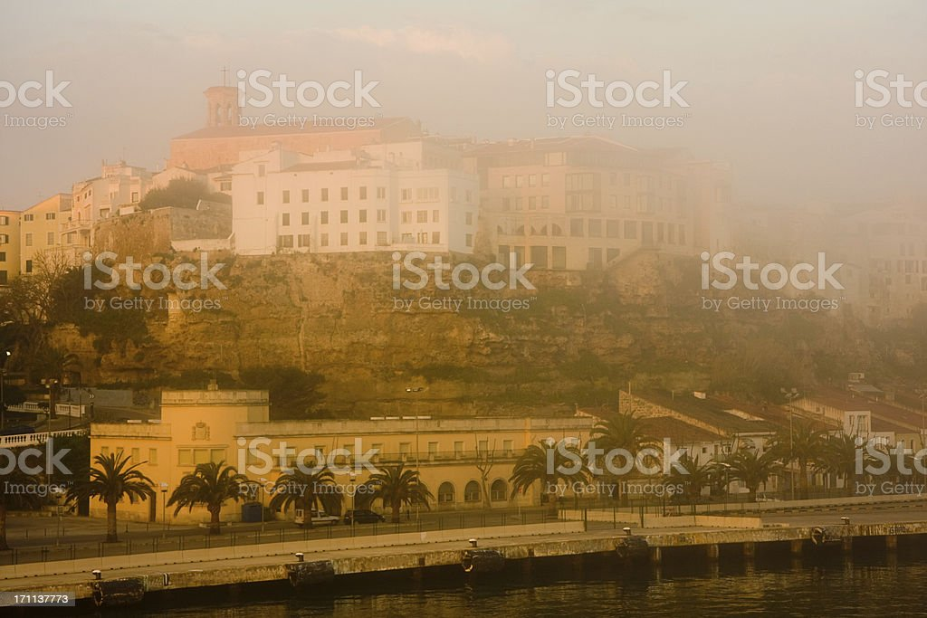foggy harbour view of Minorca at sunrise stock photo