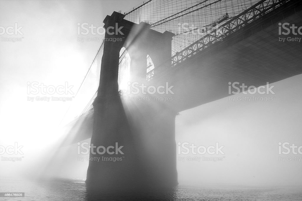 Foggy image of the Brooklyn Bridge in black and white stock photo