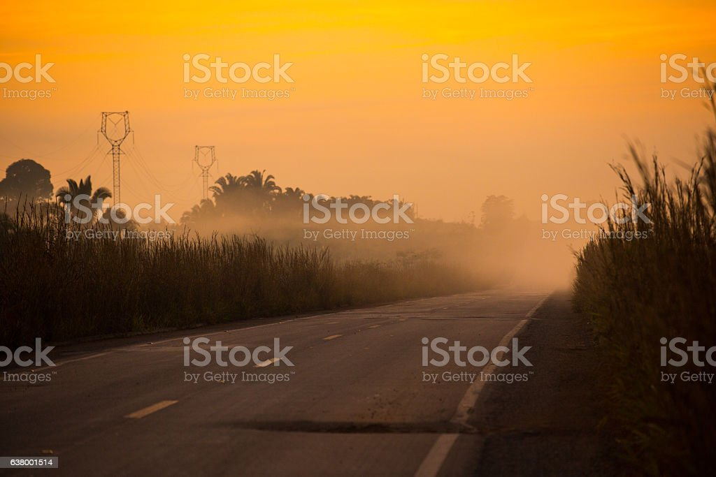 Foggy Landscape and Road during Sunrise, Amazon, Rondônia, Brazil stock photo