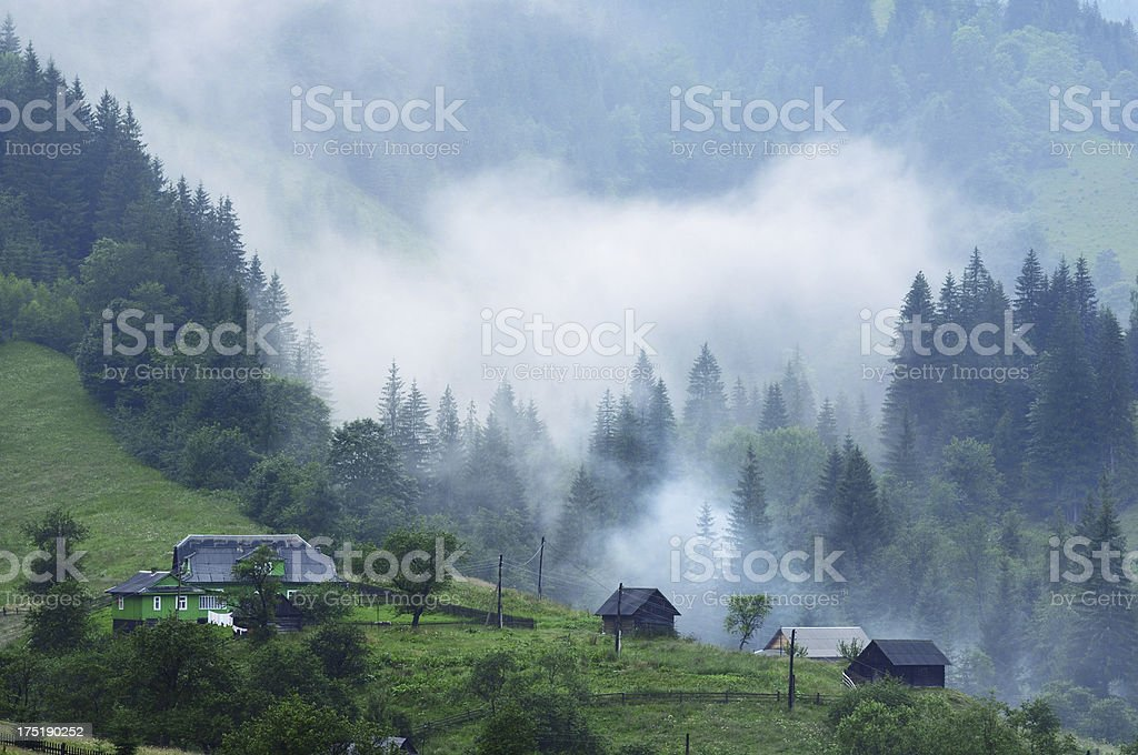Foggy landscape in mountain village royalty-free stock photo