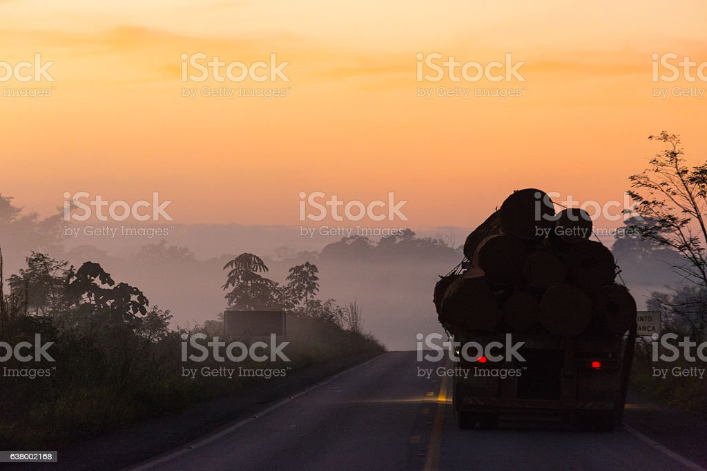 Foggy Landscape, Truck on Road during Sunrise, Amazon, Rondônia, Brazil stock photo