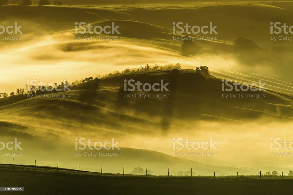 Foggy meadows in the morning, Tuscany royalty-free stock photo