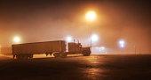 Foggy Midnight Interstate Expressway Rest Stop Parked Semi Trailer Truck