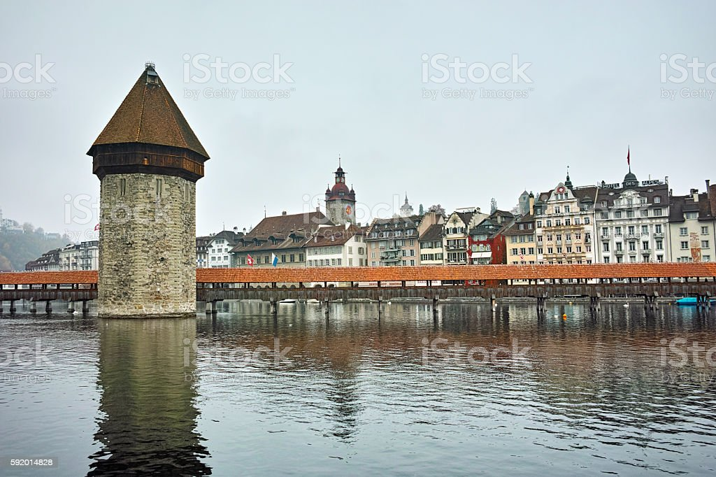 foggy morning and Chapel Bridge over Reuss River, Lucerne stock photo
