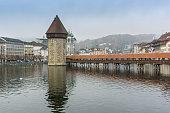 foggy morning and Chapel Bridge over Reuss River, Lucerne