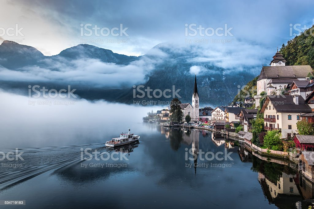 Foggy morning at the lake in the Alps stock photo