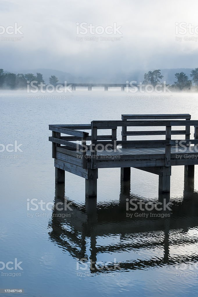 Foggy Morning Lake with Dock, Daybreak on the Water stock photo