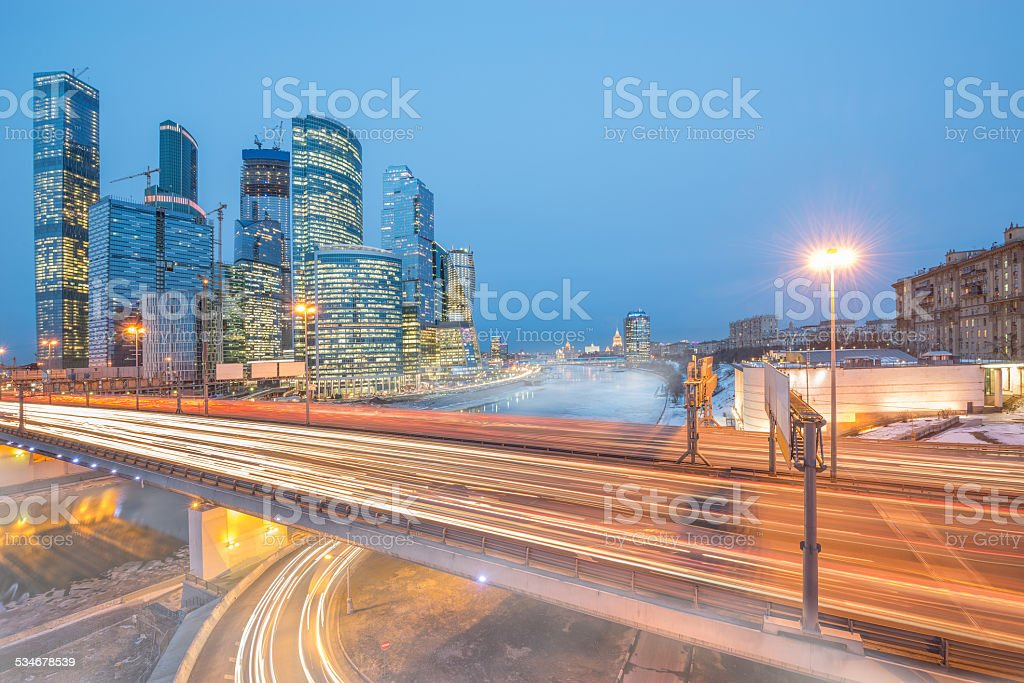 Foggy morning view of the bridge and business city center. stock photo