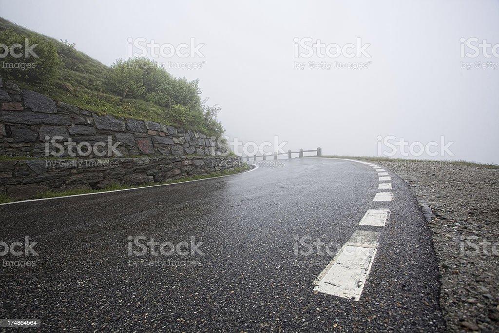 Foggy mountain road stock photo