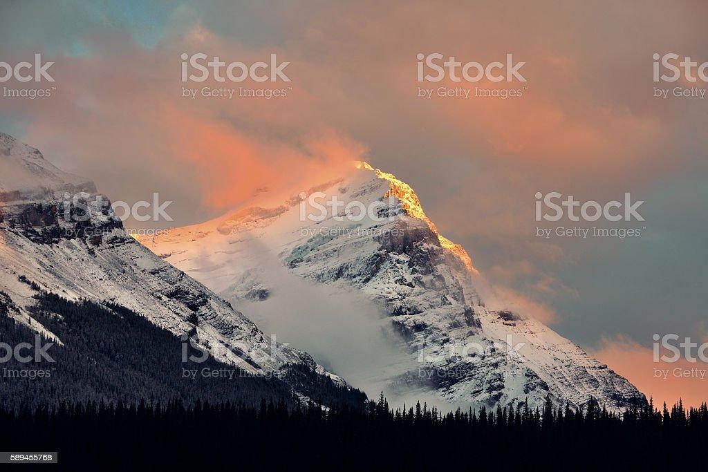 Foggy mountain sunset stock photo