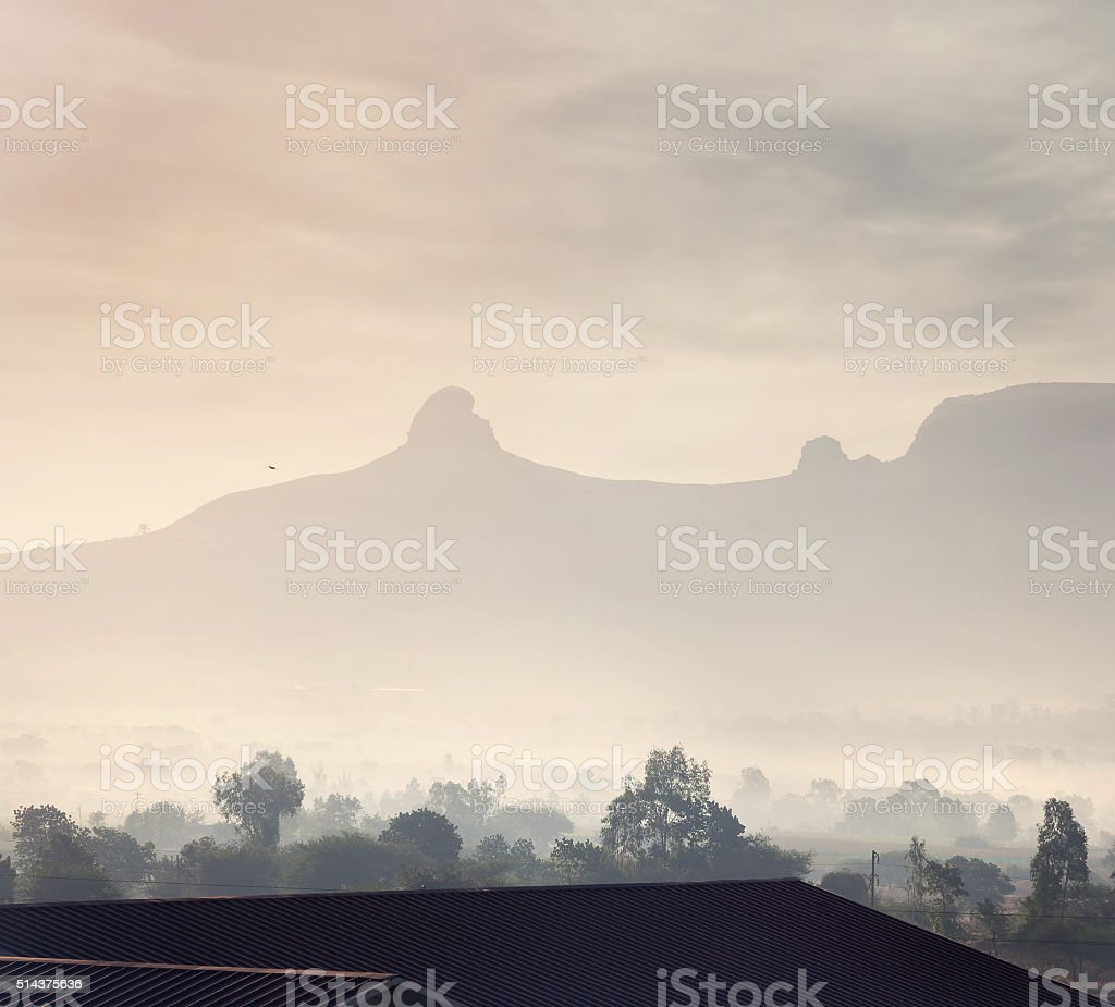 Foggy mountain valley in India stock photo