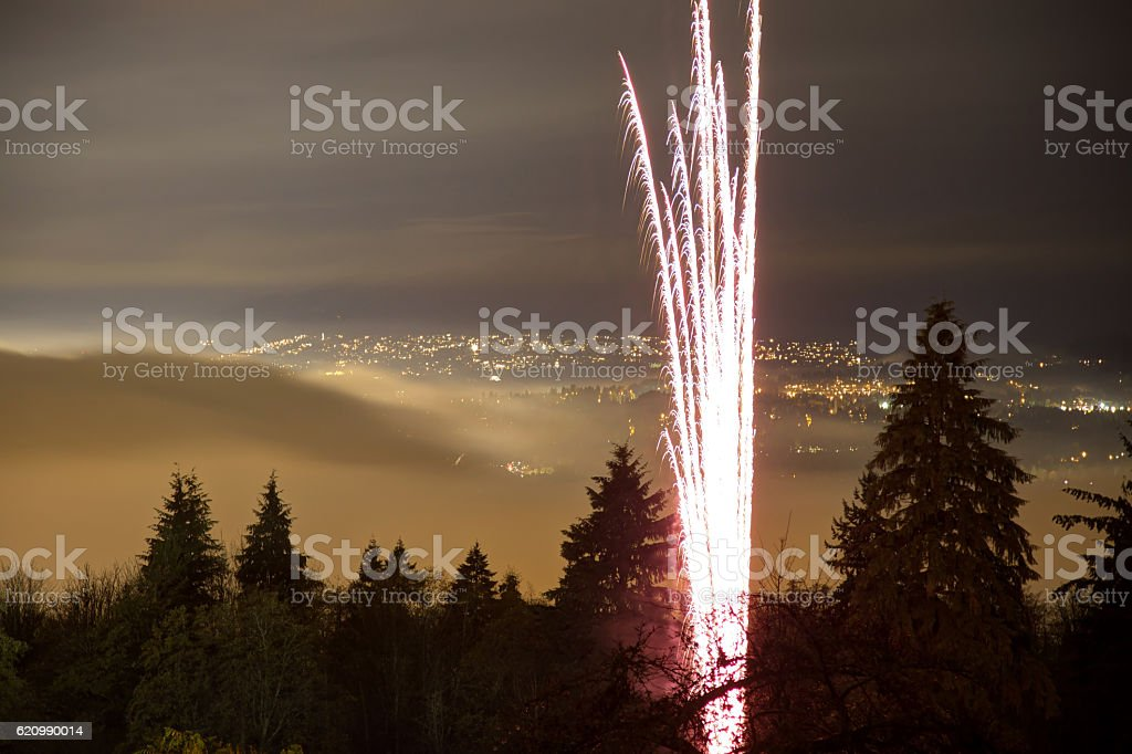 Foggy night with fireworks on top of Burnaby Mountain, Canada stock photo