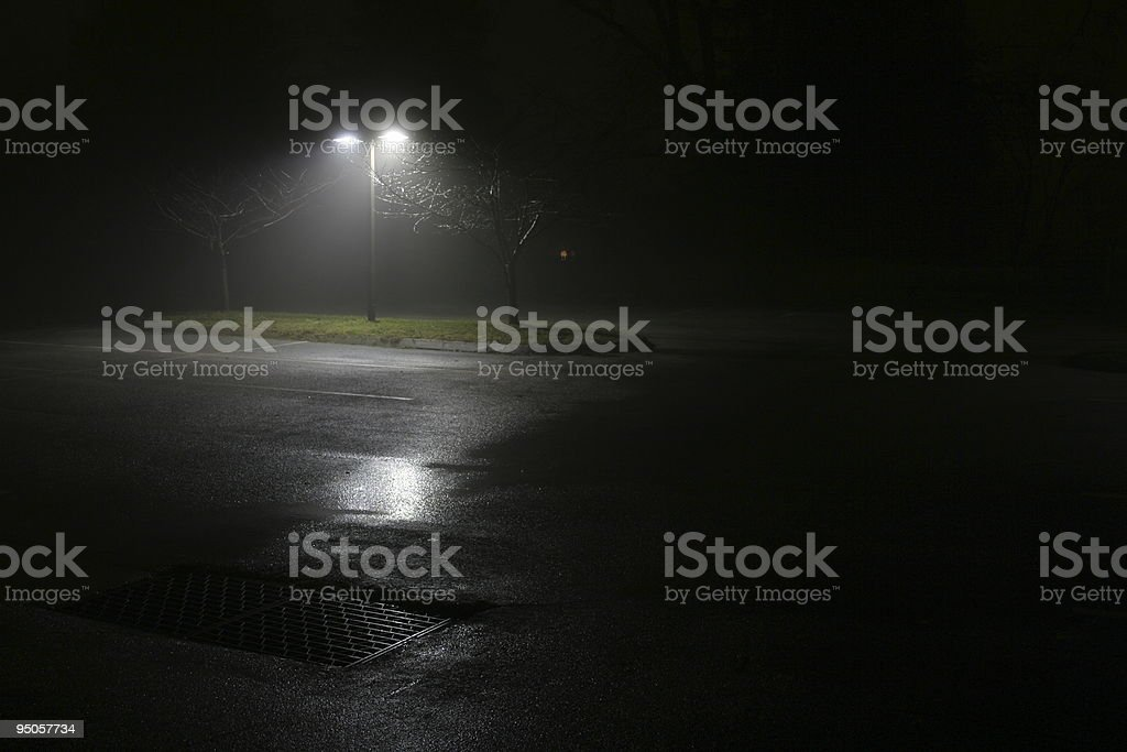 Foggy night-time parking lot stock photo