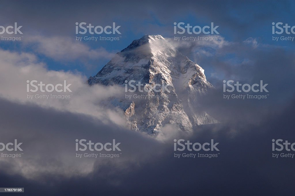 Foggy picture of the top of K2 mountain  stock photo