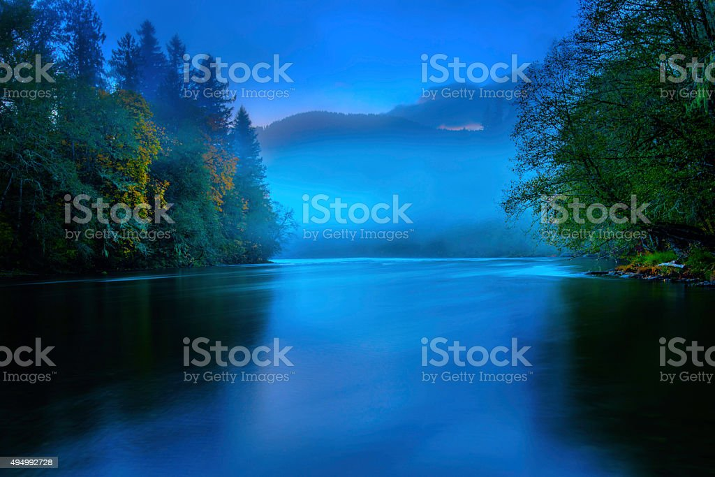 Foggy River in the evening stock photo