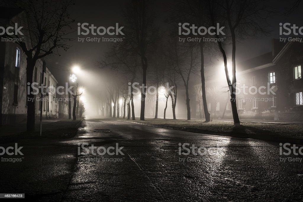 foggy road at night city stock photo