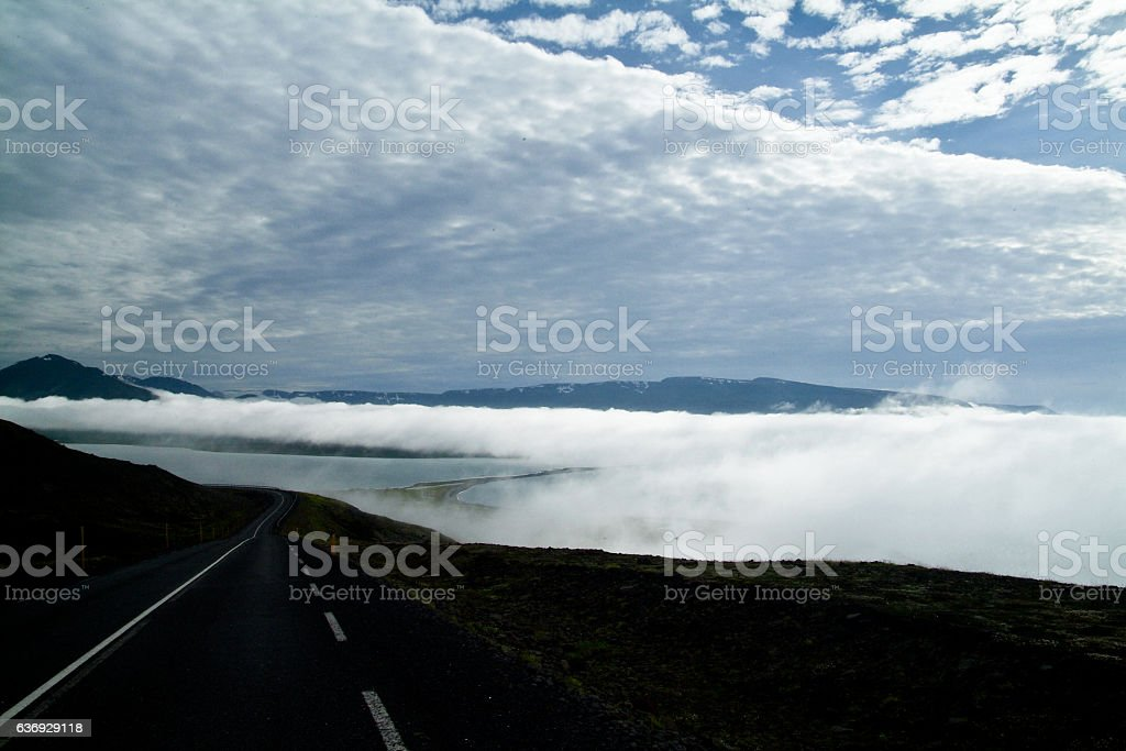 Foggy road on the middle of nothing stock photo