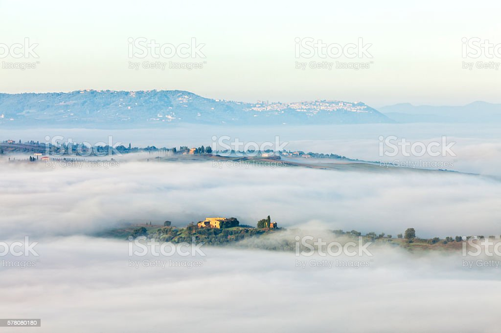 Foggy, Rolling Landscape in Tuscany, Italy stock photo