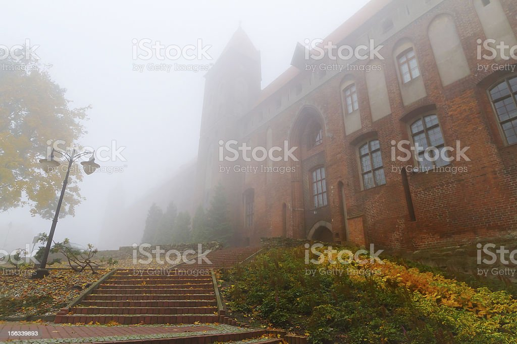 Foggy scenery of cathedral in Kwidzyn royalty-free stock photo