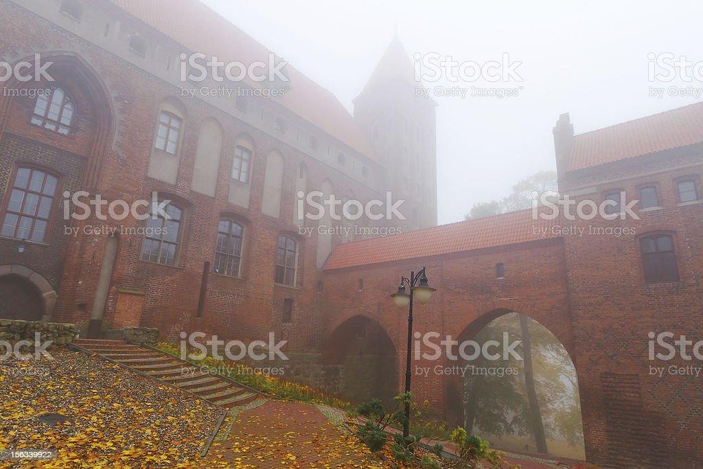 Foggy scenery of Kwidzyn cathedral stock photo