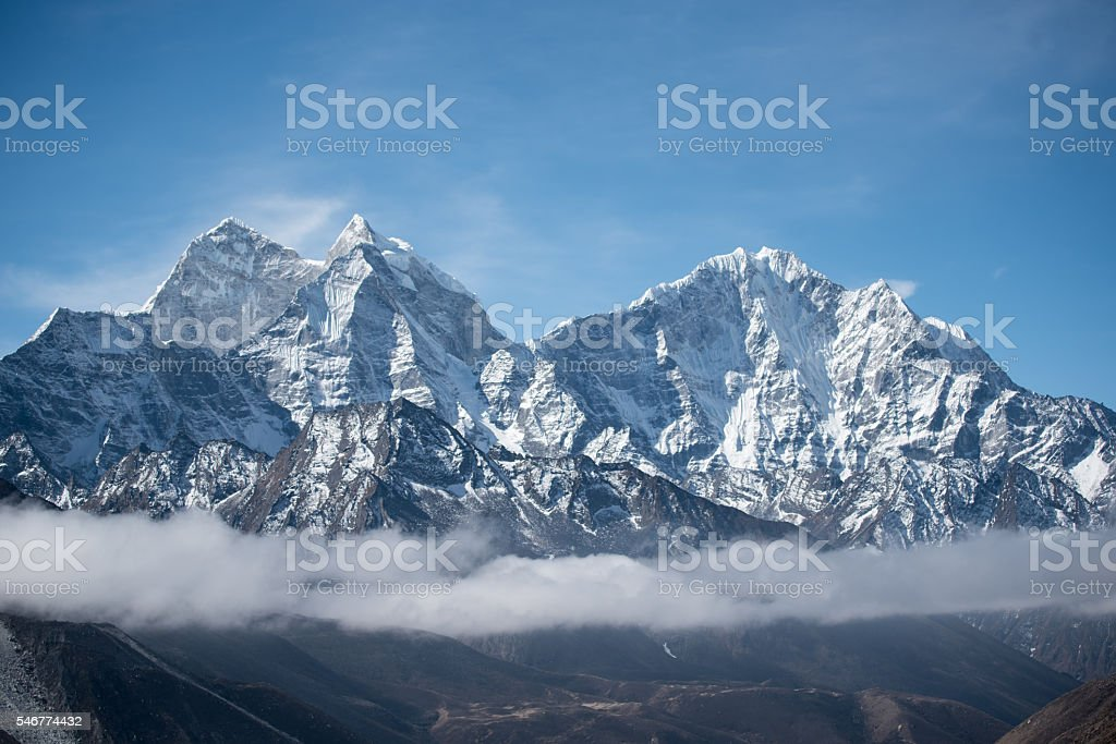Foggy snow Himalaya mountain stock photo