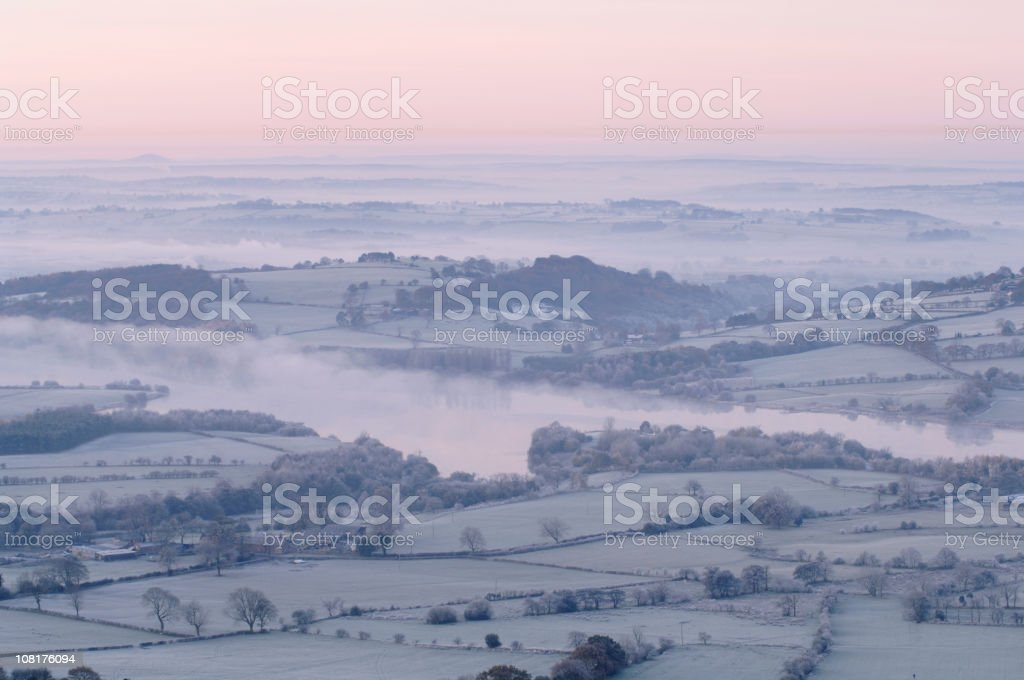 Foggy, Snowy, Winter Landscape in English Countryside stock photo