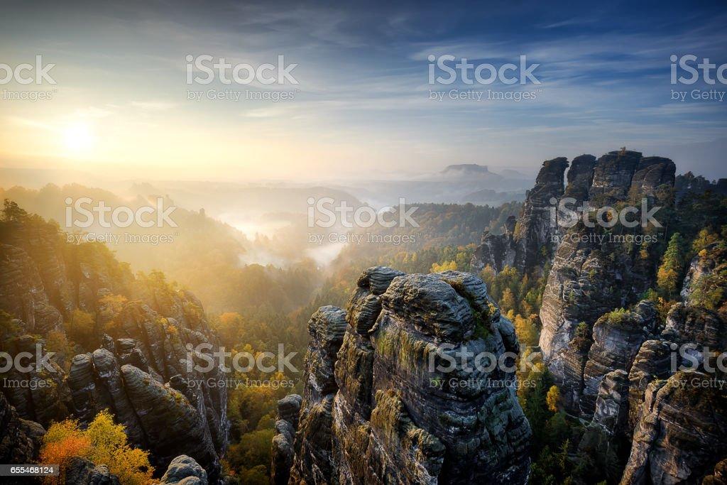 Foggy sunrise at Bastei, Saxon Switzerland, Germany stock photo