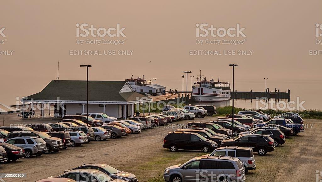 Foggy Sunrise At The Mackinaw City Docks stock photo
