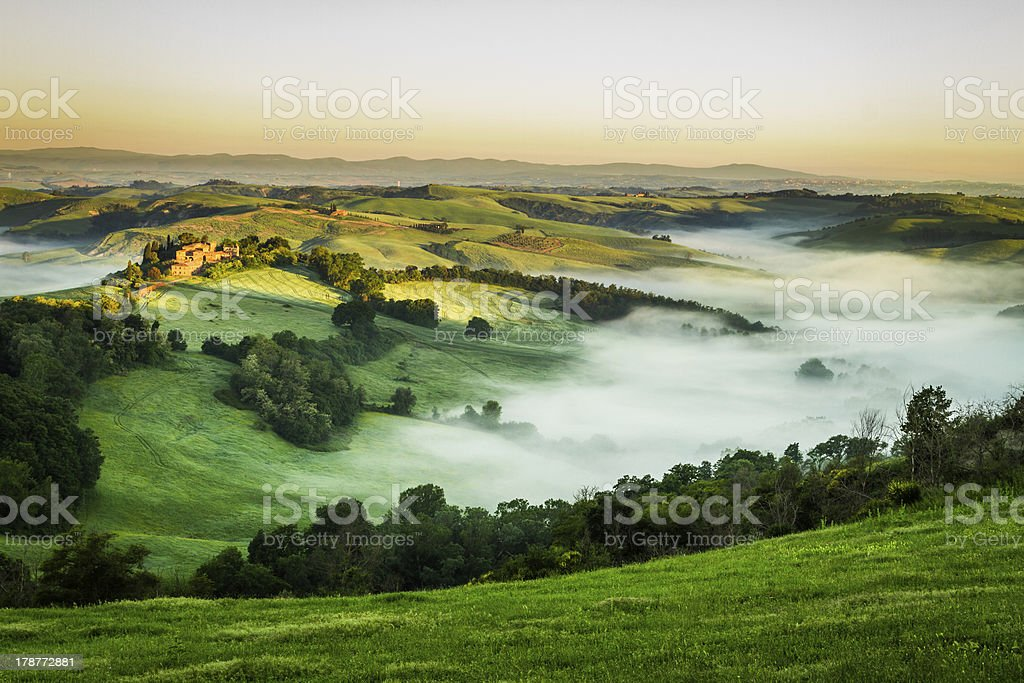 Foggy Valley in the morning, Tuscany stock photo
