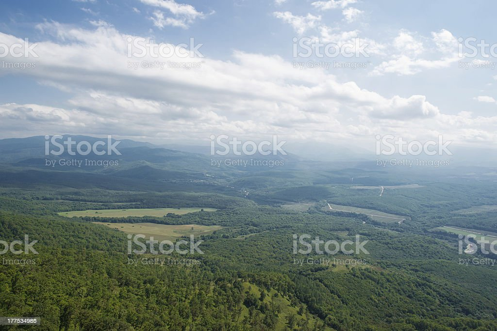 Foggy Valley with Forest and Road royalty-free stock photo