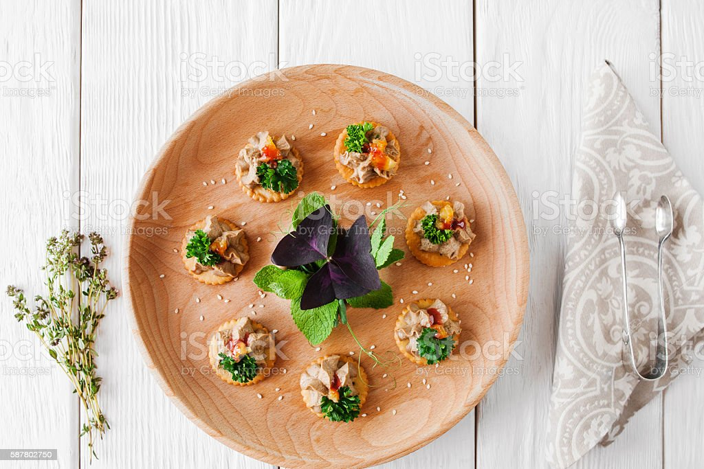 Foie gras plate on white wooden background stock photo