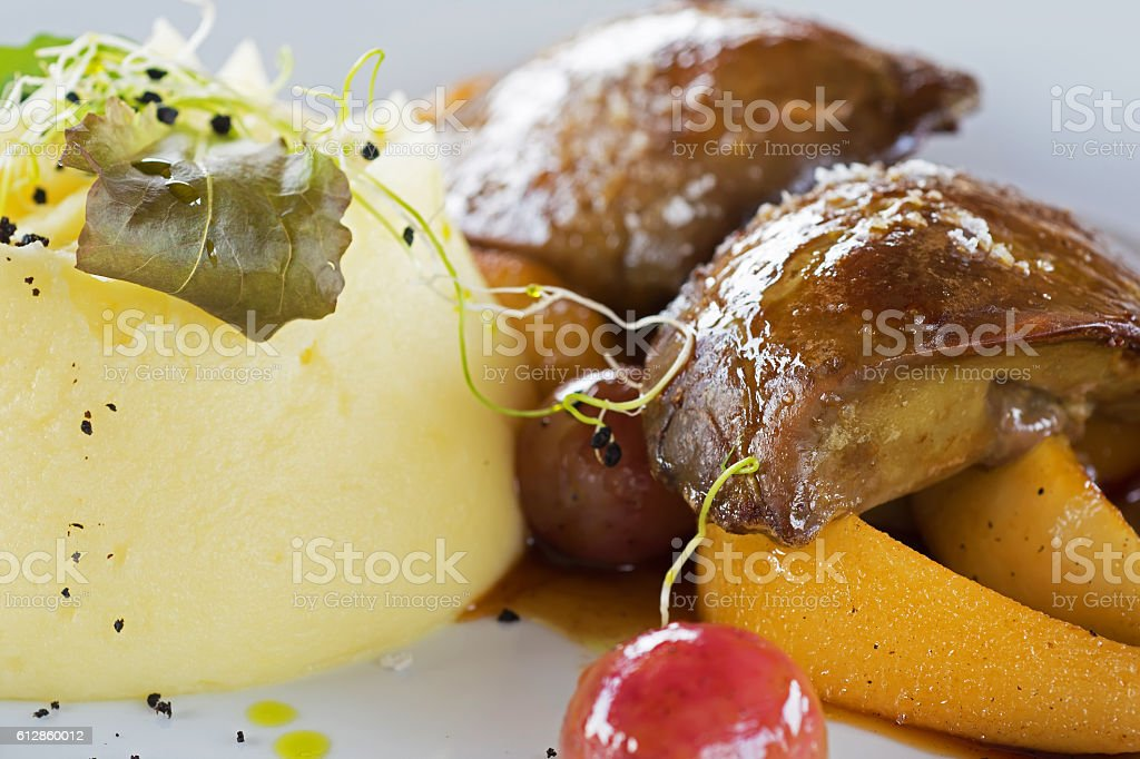 Foie Gras with Mashed Potatoes and Fruits stock photo