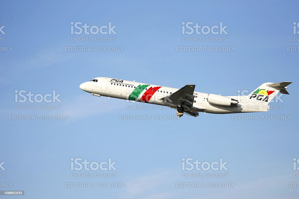 PGA Fokker 100 taking off from oporto airport stock photo