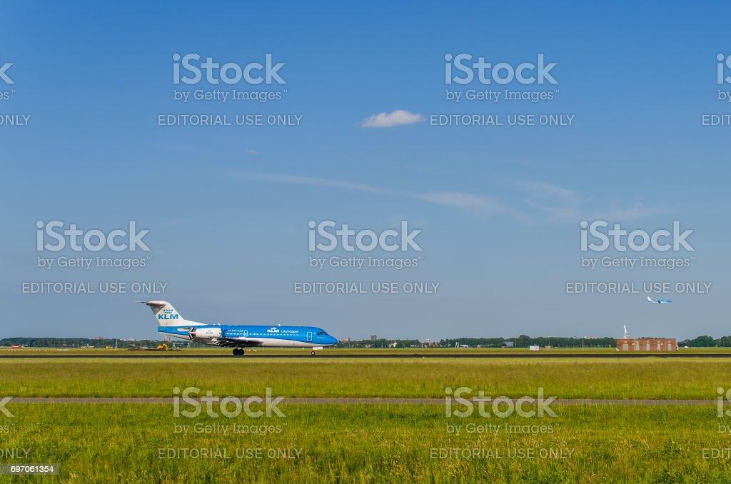 Fokker 70 of KLM Cityhopper landing at Schiphol stock photo