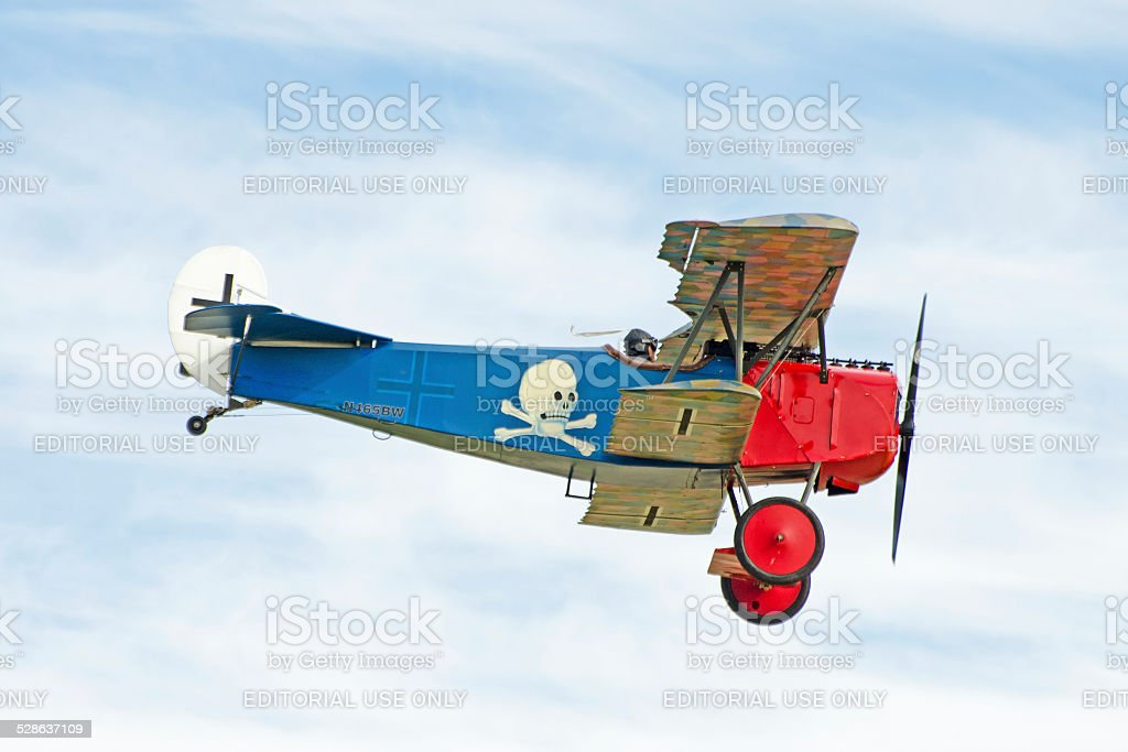 Fokker DVII WWI biplane in red and blue paint scheme stock photo