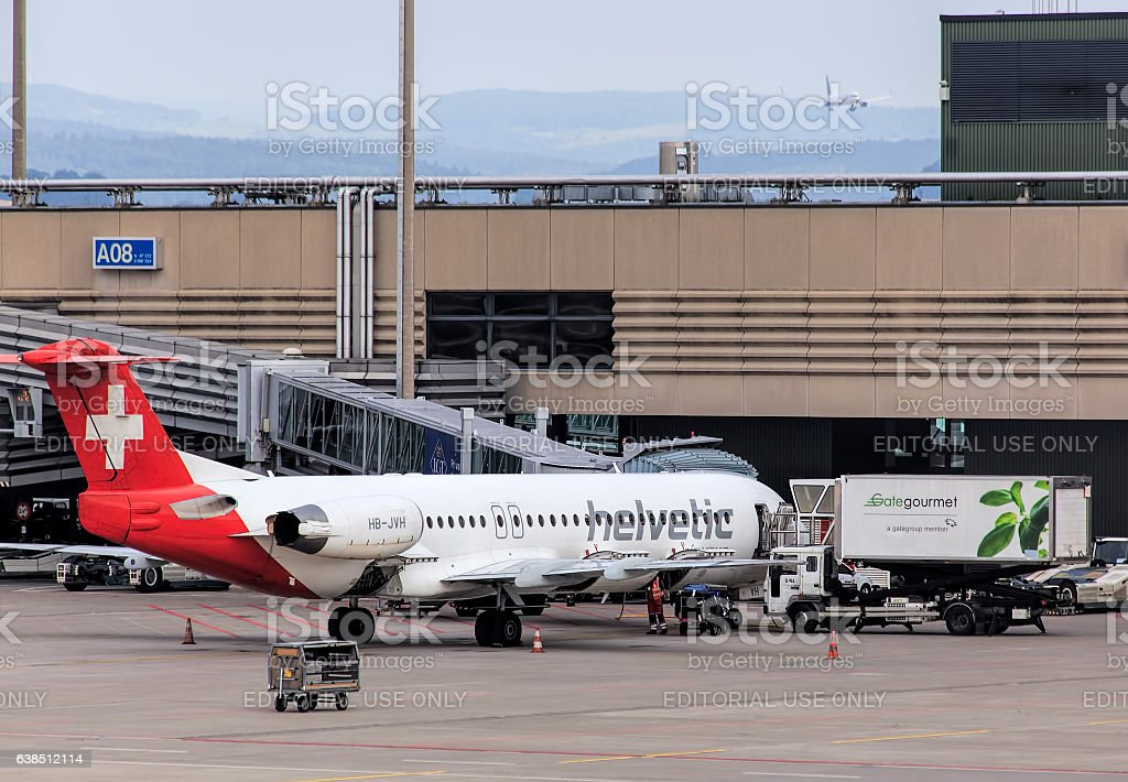 Fokker F100 airplane of Helvetic Airways in the Zurich Airport stock photo