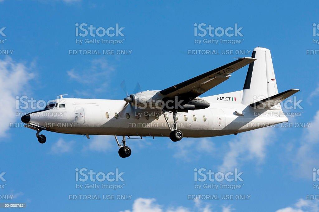 Fokker turboprop cargo plane landing stock photo