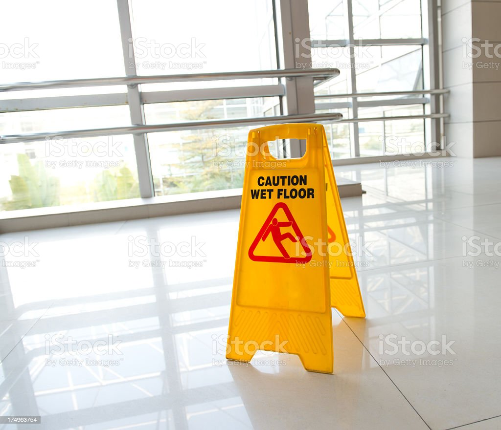 Foldable yellow wet floor warning sign stock photo