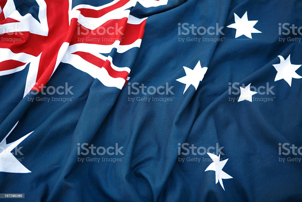 A folded Australian flag sitting in hard surface royalty-free stock photo
