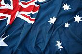 A folded Australian flag sitting in hard surface