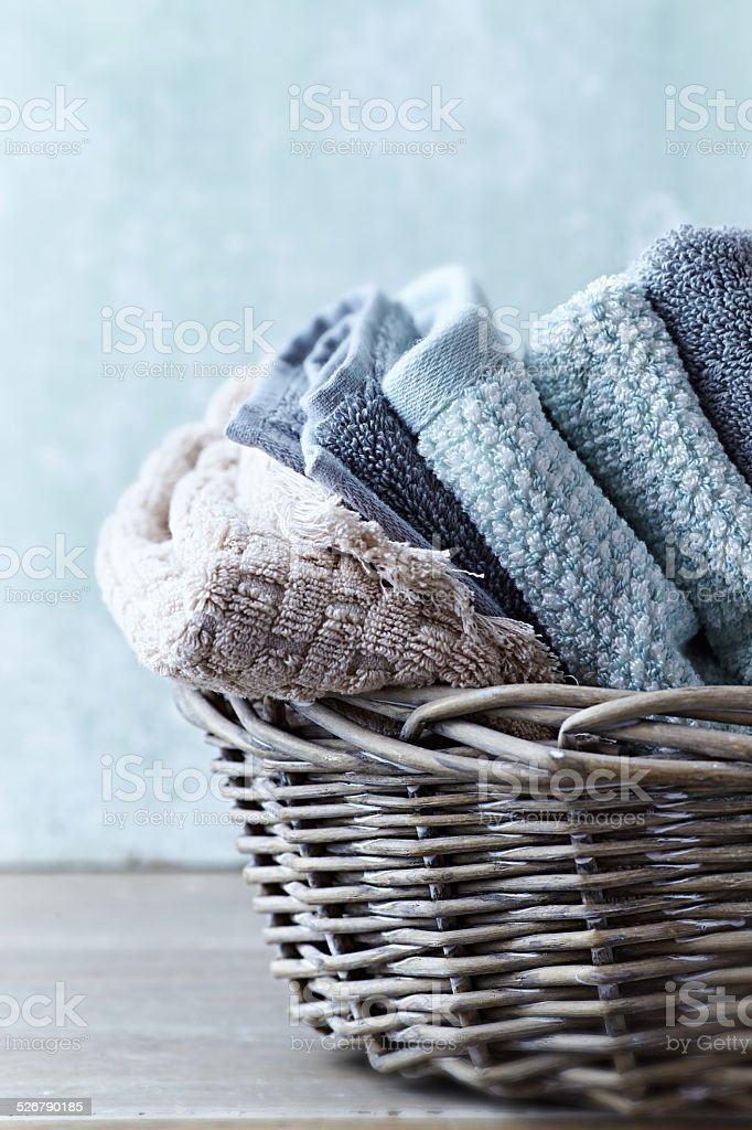 Folded Bath Towels in a Rustic Basket stock photo