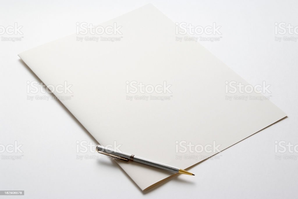 Folded blank paper with pen on white background stock photo