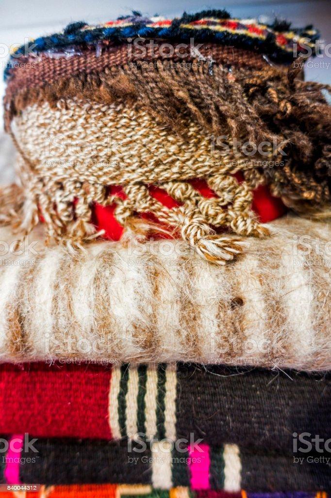 Folded carpet and rug shop stock photo