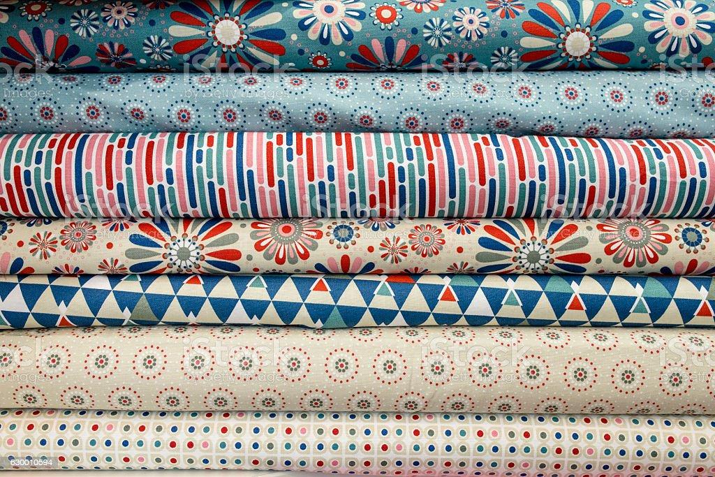 Folded fabrics of all colors stock photo