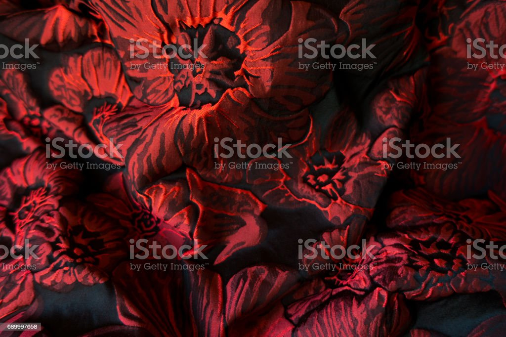 Folded jacquard fabric with wine red floral print stock photo